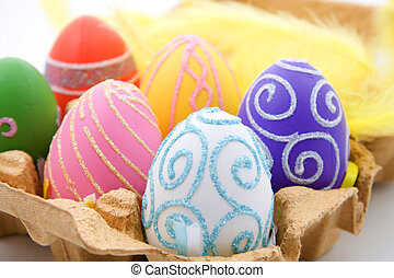 Six colorful easter eggs in box