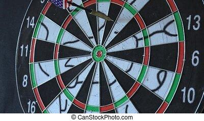 six Dart Arrows Hitting In Dartboard.