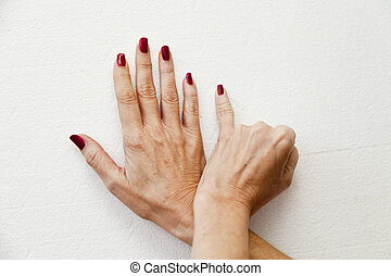 Six fingers on hands on a white background