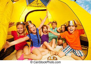 Six kids having fun in a tent