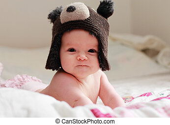 six month old adorable baby in the hat