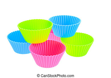 six multicolor silicone muffin pans on a white background