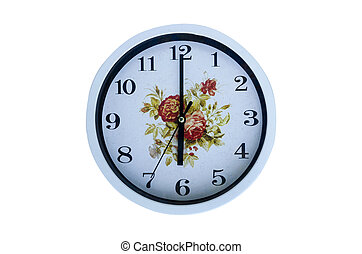 Six O'clock on the dial round clock - A white clock is on ...