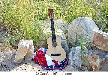 six string guitar with flag towel