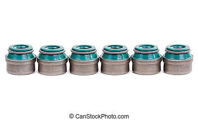 valve stem seals - six valve stem seals on a white ...