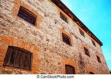 Six windows on old building