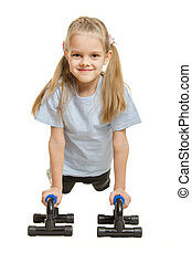 Six year old girl athlete is pushed via the stops