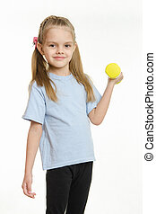 Six year old girl engaged in lifting a dumbbell exercise