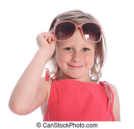 Six year old girl having fun with sunglasses