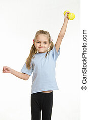 Six year old girl held up a dumbbell