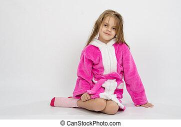 Six year old girl in a bathrobe