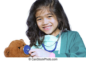 Six year old girl playing doctor