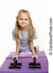 Six year old girl pushed with stops for push-ups