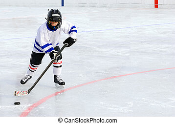 Six Year Old Hockey Player Racing with the Puck