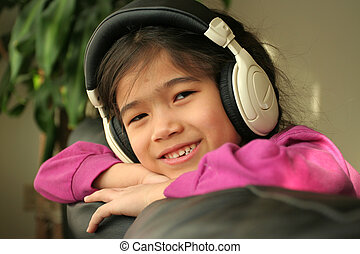 Six year old listening to music