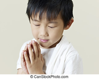 little asian boy - six year old little asian boy praying.