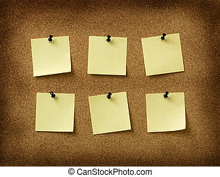 six yellow notes pinned to grunge cork background