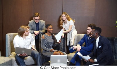 Six Young Businesspeople Having Discussion. - Six Young...