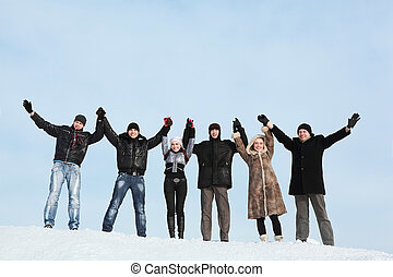 Six young people hold on hands and lift them upwards