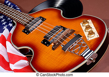 Old 1960's Style Rock And Roll Electric Guitar With The American Stars And Stripes Flag And LP Record