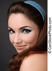 Sixties - Portrait of beautiful smiling girl with cat eyes...