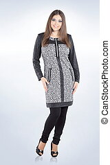 size plus.Young woman in casual wear - size plus. Young...