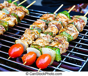 Sizzling barbecue sticks with meat and vegetables