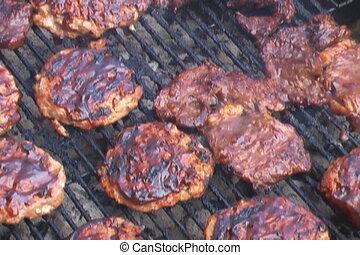 Sizzling hamburger patties on BBQ grill - Sizzling hamburger...