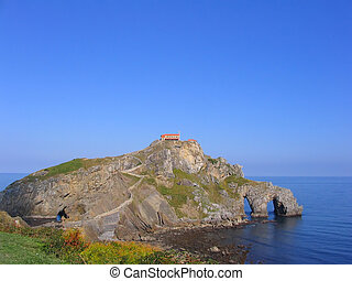 San Juan de Gaztelugatxe (Basque Coast, Spain). This little chapel is build on top of a small island connected to land only by a steep stone stairway with more than 200 steps