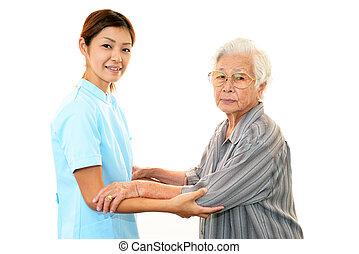 sköta, med, äldre kvinna