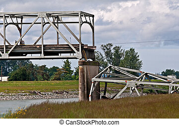 SKAGIT COUNTY, WA – MAY 23: Steel bridge collapses due to a truck hitting a part of the bridge. Main interstate I-5 impacts region. May 23, 2013 in Skagit County, Wa