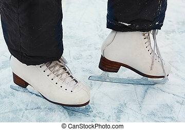 skate boots on teen girl feet close up photo