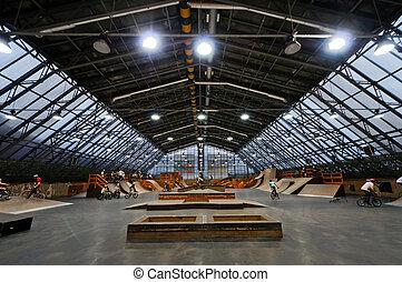 Skate park symmetric horisontal interior with bike riders