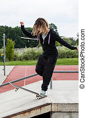 Skate teen girl rides on a skateboard