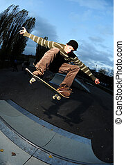 skateboard action - skateboarder in action at the local...