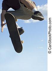 skateboard jump - skateboarder jumping a ramp. Blurred for...