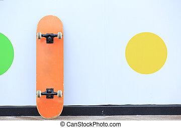 skateboard lean on wall