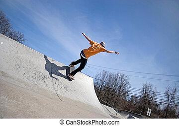 Skateboard Ramp - Portrait of a young skateboarder skating ...