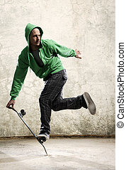 Skateboard skill - Skilled skateboarder does a trick in...