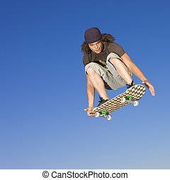 Skateboard tricks - Teen boy does tricks in the half pipe at...