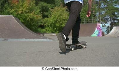 Skateboard Turn - Slow motion of cropped man skateboarding...