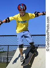Skateboarder 00058a - Boy skateboarding in mid-drop from a...