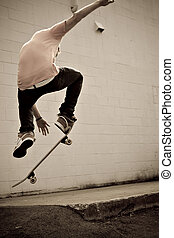 Skateboarder - A young skateboarder doing a stunt in an ...