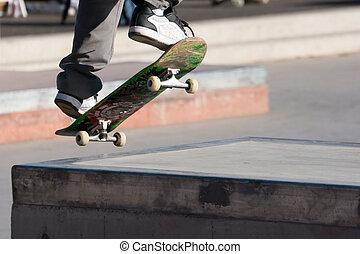 Skateboarder airborne