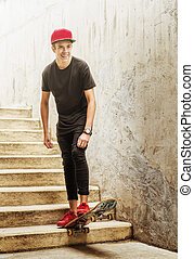 Skateboarder boy jumped from the stairs