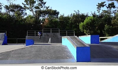 Skateboarder doing an ollie on ramp on a local skate park.