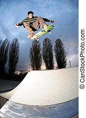 skateboarder flying high - skateboarder in action at the ...