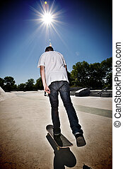 Skateboarder getting ready for his practise