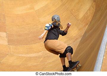 skateboarder going - skateboarder riding the bowl