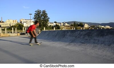 Skateboarder grinding a curb